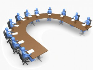 Royalty-free 3d business computer generated clipart graphic picture of a group of blue people seated and holding a meeting at a large u shaped conference table.